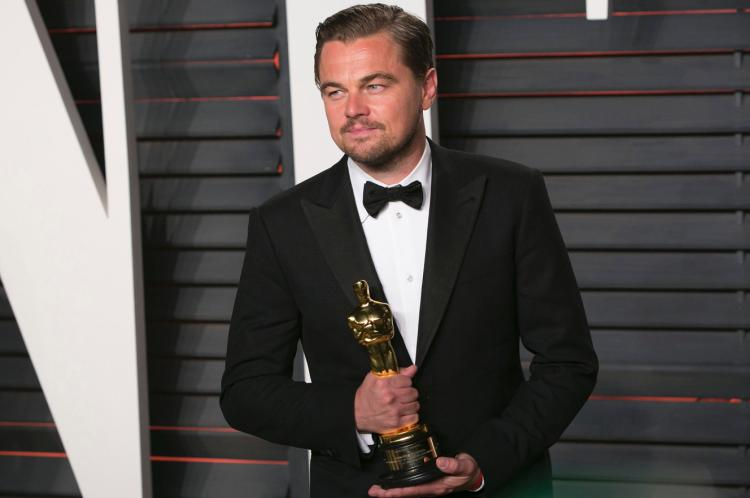 Leo clutching (finally) his own Oscar won last year
