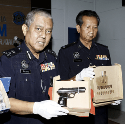 Automatic pistol and live ammunition shown to the public