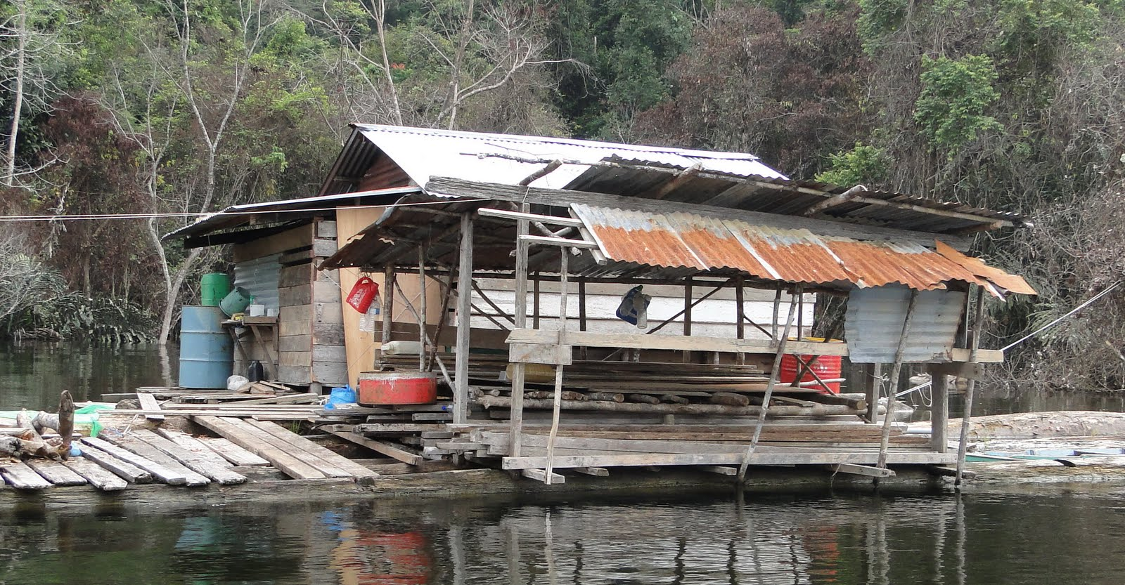 Scene of modernity? - The floating homes of Bakun where desperate tribespeople have returned to their old lands, destroyed by flooding.