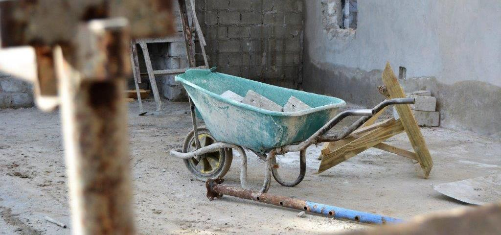 A wheelbarrow in a Sardinia Bay Estate home that is being built.