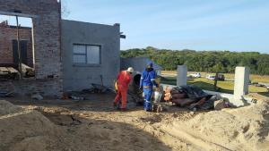 Workers in action building a Sardinia Bay Estate home.