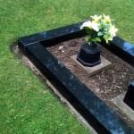 black kerbstones tidied grave