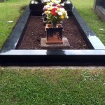 Black granite kerbstones for grave