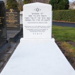 White Jewish headstone with marble slab
