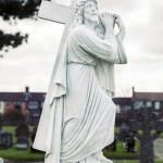 full statue Jesus carrying a cross memorial