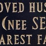 new lettering on a black granite memoria