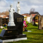 granite stepped gravestone and white marble boy child Jesus