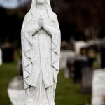 Our Lady white marble gravestone