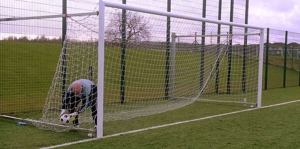 Muers, doing what he does best, picking up the ball out of the net, after being lobbed, again.