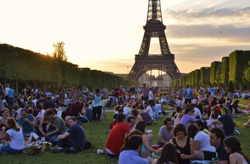 Picnic in front of the Eiffel Tower, Paris, France