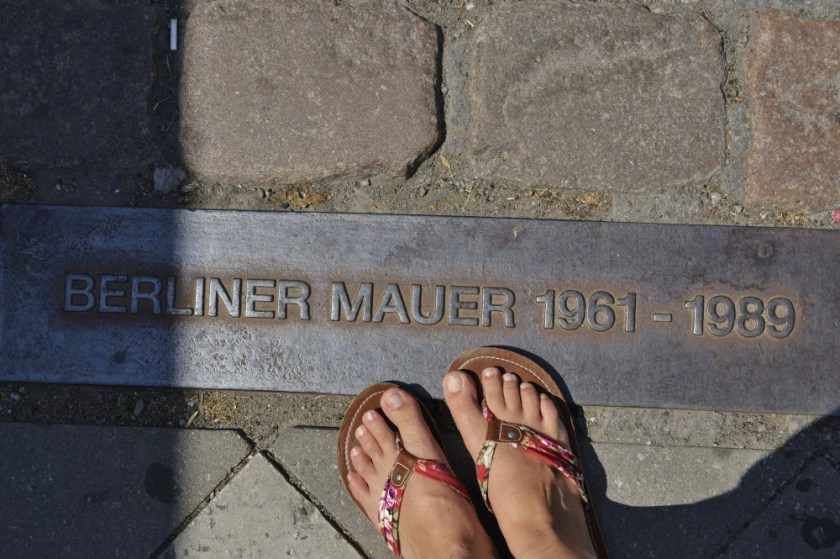 Standing on the former Berlin Wall, Germany