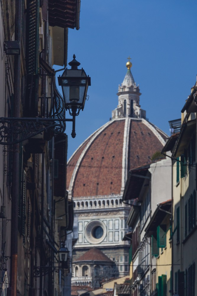 The dome of the Duomo can be seen peeking through in so many of the little old streets in Florence!