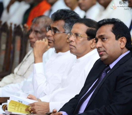 President Maithripala Sirisena (second on the right) with cabinet ministers Akila Viraj Kariyawasam and Champika Ranawaka hearing about the potential for mindfulness in politics