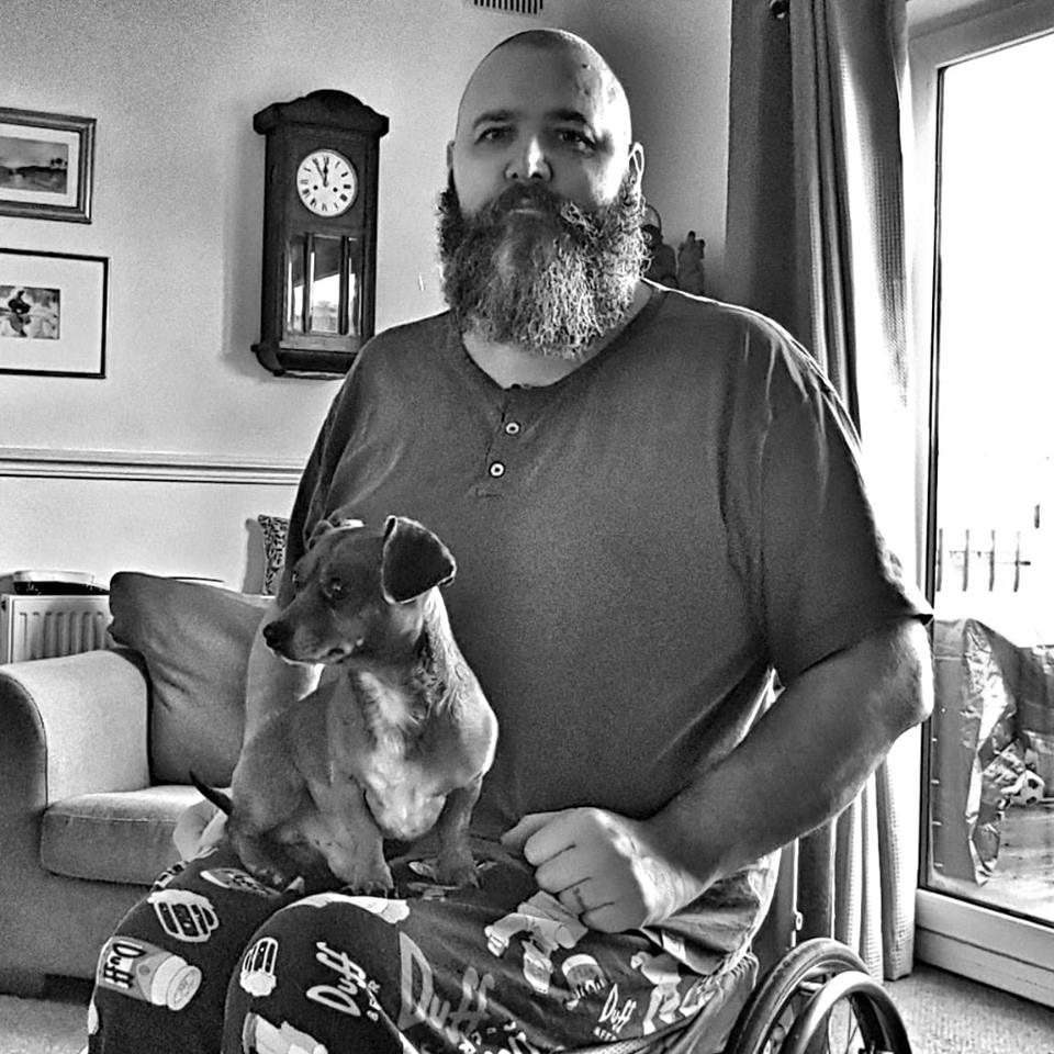 Me in wheelchair with dog on lap