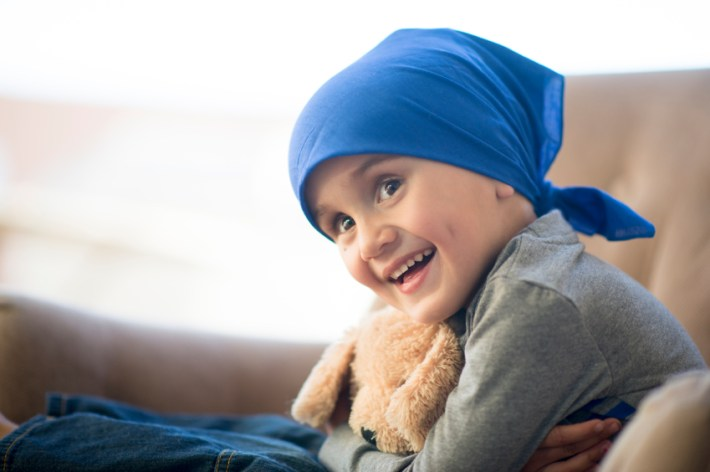 Little boy and his teddy bear after a chemotherapy treatment