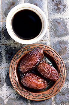 Medjool dates, shown with a demitasse of Turkish coffee, are the number two date crop in the US, and they came to the Coachella Valley from Morocco.