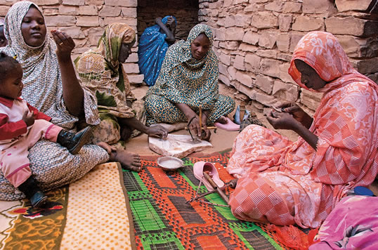 Smoothing each fragment of shell on a granite slab and carefully hand-drilling it with up to five holes, the women of Tichit have made beads a specialty. They trade their beads throughout Mauritania and into Mali.