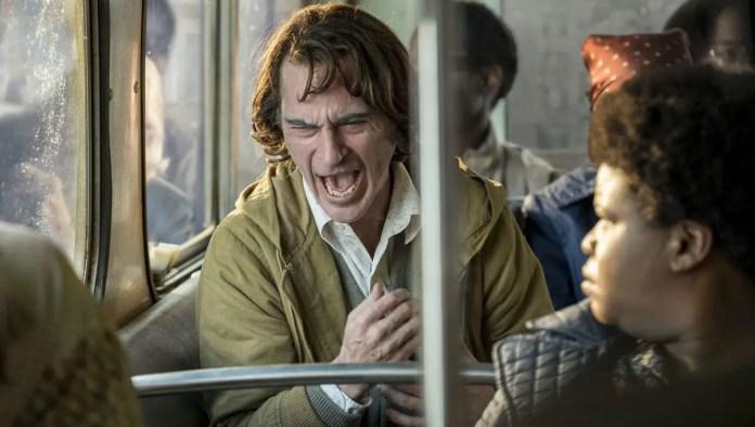 Joker laughing/crying on bus