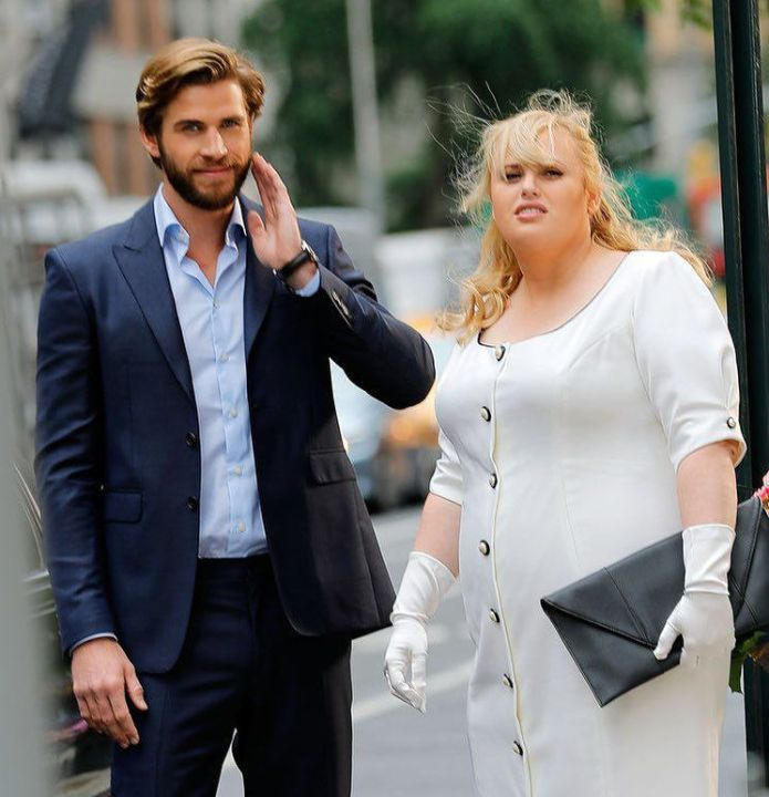Hemsworth and Wilson sued by paparazzi