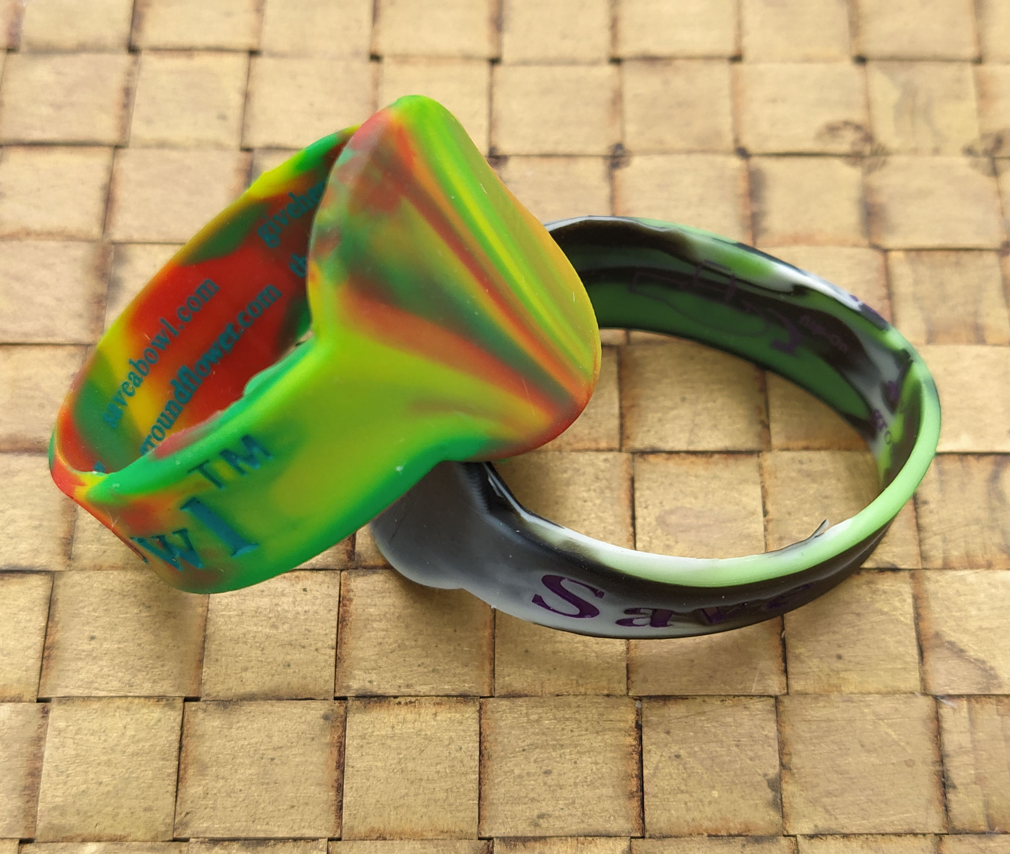 image of 2 different colore save-a-bowls on a glass pipe