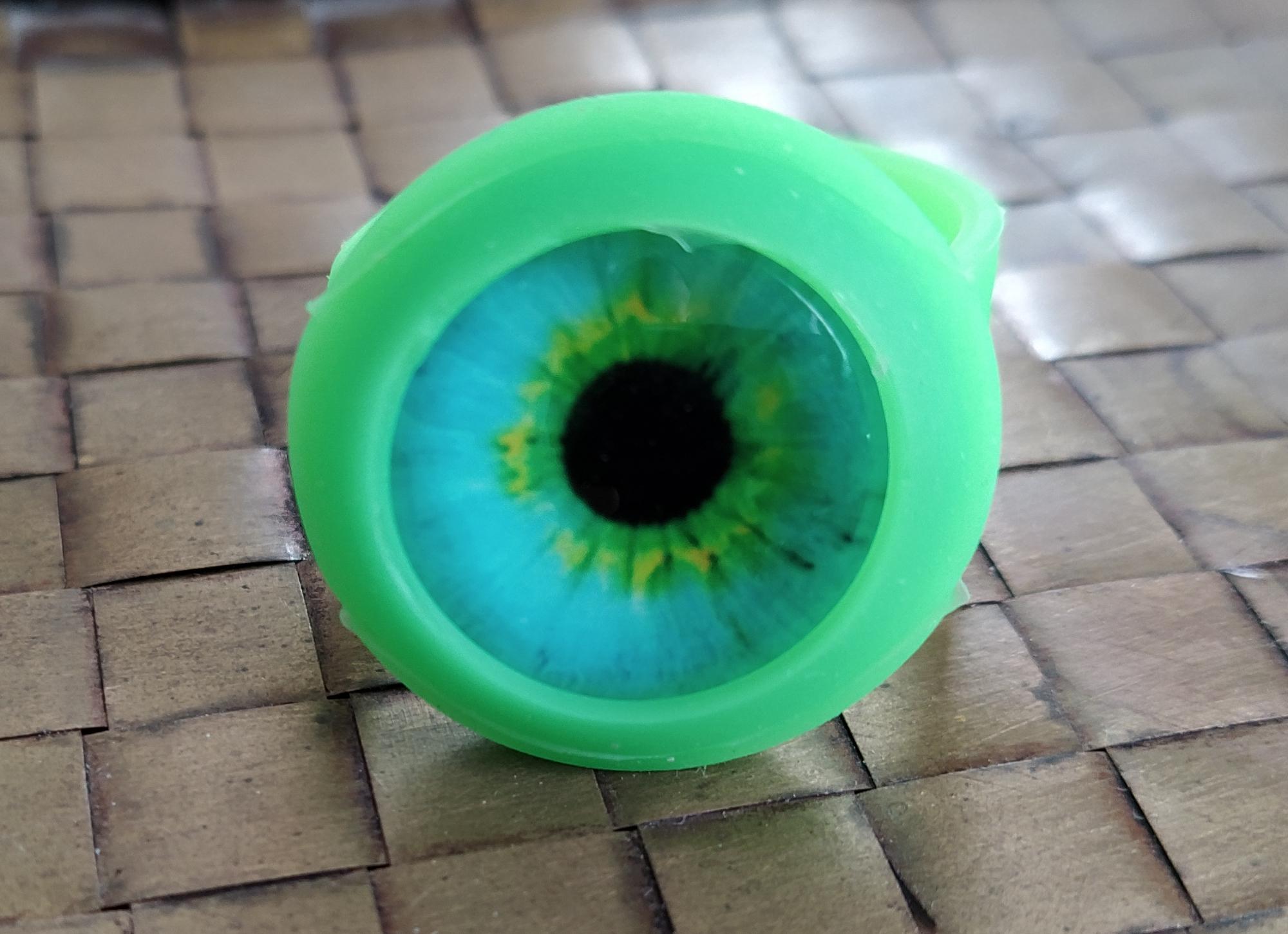 close up of the blue-green eyeball cabochon bowl saver