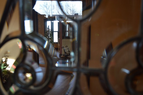 The living room is seen through the beveled glass of the front door. (photo/Cindy Hadish)