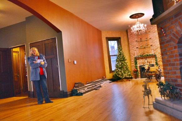 Donna Cardis, who lives next door to the Victorian home, stops by to visit her son in December. (photo/Cindy Hadish)