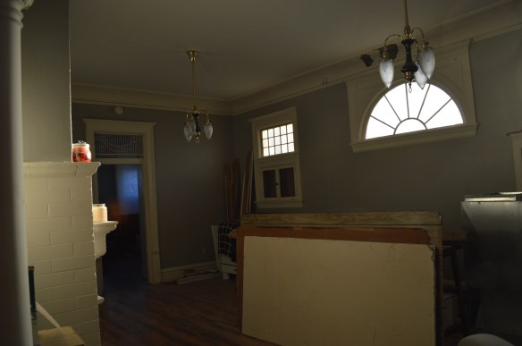Original windows and light fixtures are among the features in the Brewer House library. The historic home will be moved about 10 blocks away to save it from demolition. (photo/Cindy Hadish)
