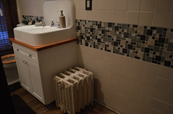 An original radiator is among the features that Mark Cardis is keeping in the home he is restoring. (photo/Cindy Hadish)