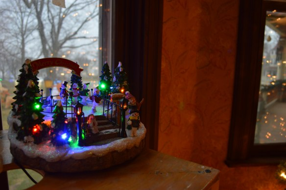 Christmas decorations can be found throughout the home, highlighting windows that have been restored. (photo/Cindy Hadish)