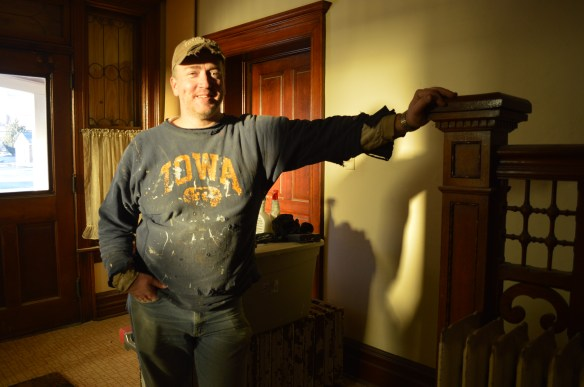 Greg Young of Cedar Rapids takes a break from restoration work inside the Brewer House on Dec. 28, 2013. (photo/Cindy Hadish)