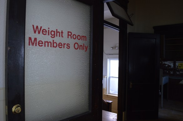 A sign outside the weight room in the Sokol building reflects the physical activities the organization promoted. The gymnastics program relocated from downtown Cedar Rapids after the floods of 2008. (photo/Cindy Hadish)