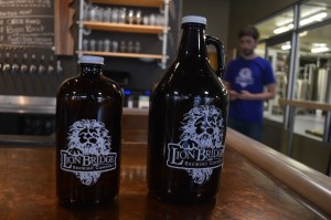 "Lion Bridge Brewing Company's refillable growler and smaller ""meowler"" are among the ways the business promotes environmentally friendly practices. (photo/Cindy Hadish)"