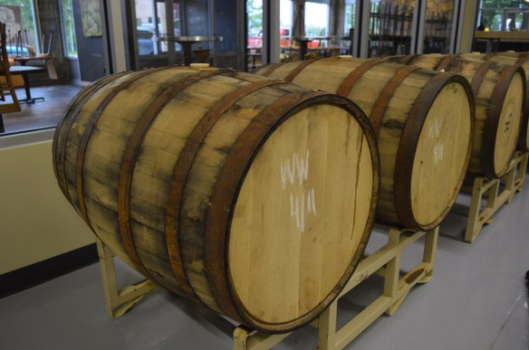 Repurposed wooden barrels are used in the brewhouse of Lion Bridge Brewing Company in Cedar Rapids. (photo/Cindy Hadish)