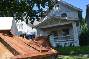 Cedar Rapids Historian Mark Stoffer Hunter considers homes in the 1500 block of A Avenue NE particularly vulnerable to the threat of demolition since the flash floods in June 2014. (photo/Cindy Hadish)