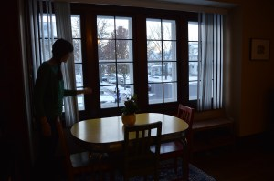Windows that span one side of the living room offer a view of Bever Avenue SE. (photo/Cindy Hadish)