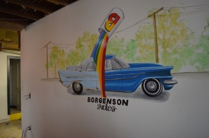 A more recent mural painted for Borgenson Automotive Paint remains inside the building. (photo/Cindy Hadish)