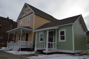 Jon Jelinek and his son, Nick, restored these homes at 1113 and 1117 Third St. SE. The two-story home now houses Ruhl & Ruhl Realtors downstairs and an apartment above. The single story home will become a bed-and-breakfast. (photo/Cindy Hadish)