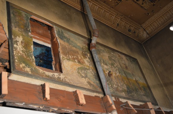 Two murals depicting nature scenes inside the former Ideal Theatre have been damaged and are likely unsalvageable. (photo/Cindy Hadish)