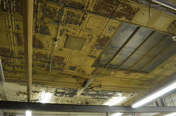 The original tin ceiling and what appears to be a skylight was revealed when a drop-ceiling was removed inside the former Ideal Theatre. (photo/Cindy Hadish)