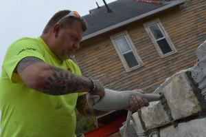 Joe Luchtenburg, of A-1 Masonry, works on the limestone being added to the foundation of the Frankie House. He will demonstrate historic masonry techniques on Nov. 24, 2015. (photo/Cindy Hadish)