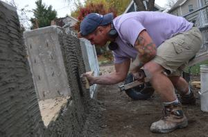 Michael Douglas, a graduate of Kirkwood's masonry program, works on the Frankie House at 1425 Fifth Ave. SE. (photo/Cindy Hadish)