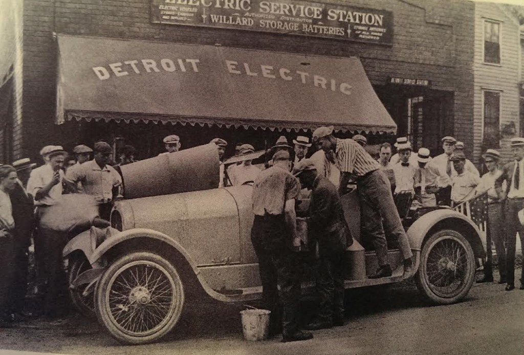 "This 1916 photo shows a Marmon model car stopped at 616 Second Ave. SE on its way to break a coast to coast speed record of five days and 18 and a half hours. The man in the striped shirt was the ""navigator"" hired to guide the Marmon and its driver from Lyons, Iowa, to Ames. The man in the striped shirt is Bedford ""Bud"" Lattner of Cedar Rapids. (photo/The History Center)"