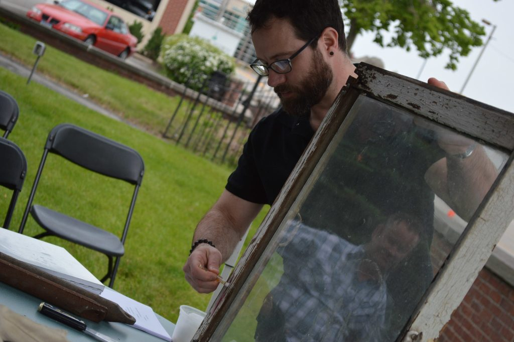 Kirkwood Community College instructor Ryan Prochaska demonstrates how to test for lead paint during a window workshop at the Preservation Showcase on May 7, 2016. (photo/Cindy Hadish)