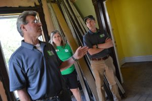 Steve Thomas, left, discusses the interior of the Frankie House, along with Jeff Capps, executive director of the Cedar Valley Habitat for Humanity. (photo/Cindy Hadish)