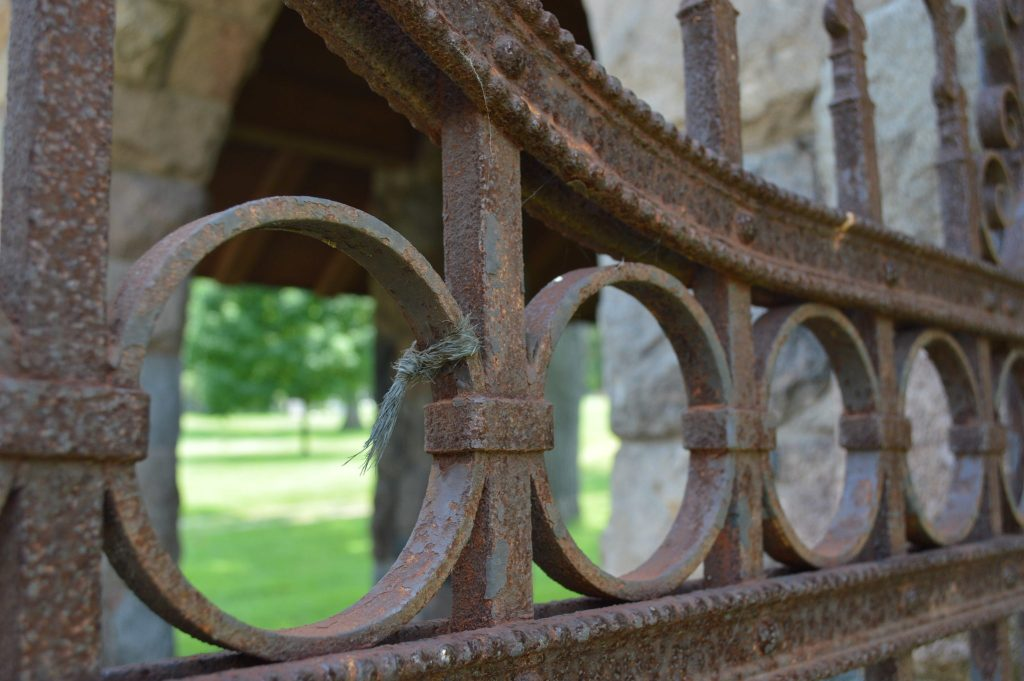 A decorative iron gate is among the architectural features at the historic Oak Hill Cemetery. (photo/Cindy Hadish)