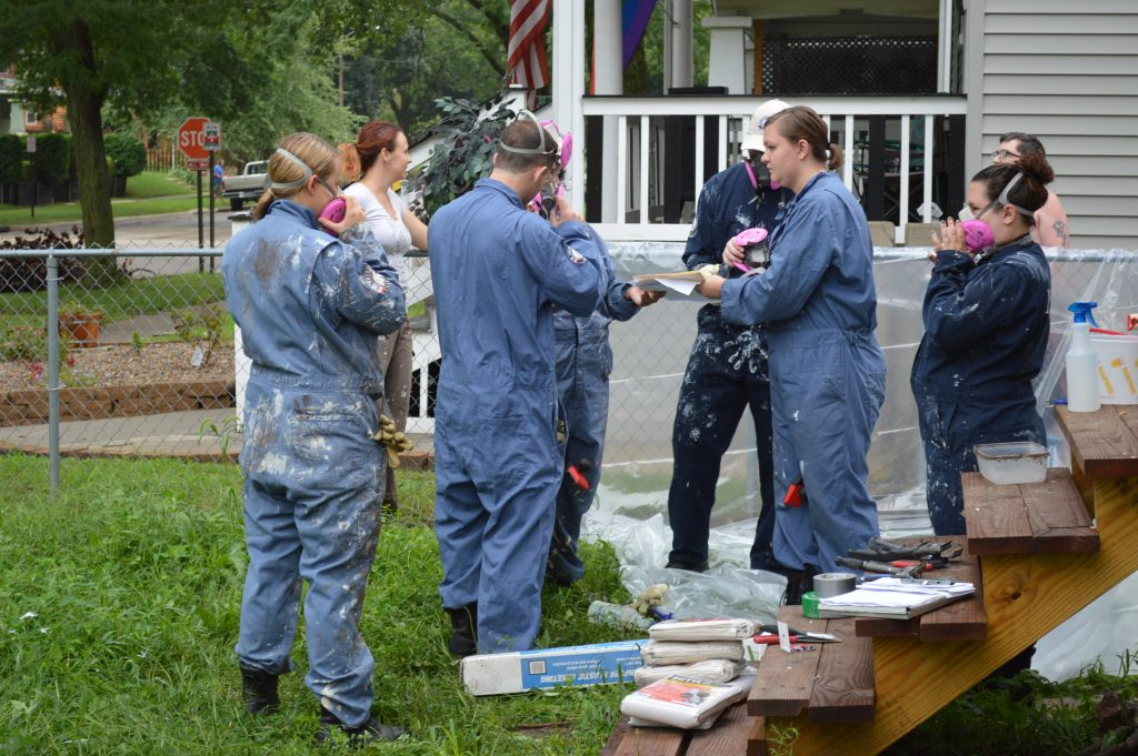 AmeriCorps NCCC members prepare to scrape paint on the Frankie House on Friday, Aug. 12, 2016. (photo/Cindy Hadish)