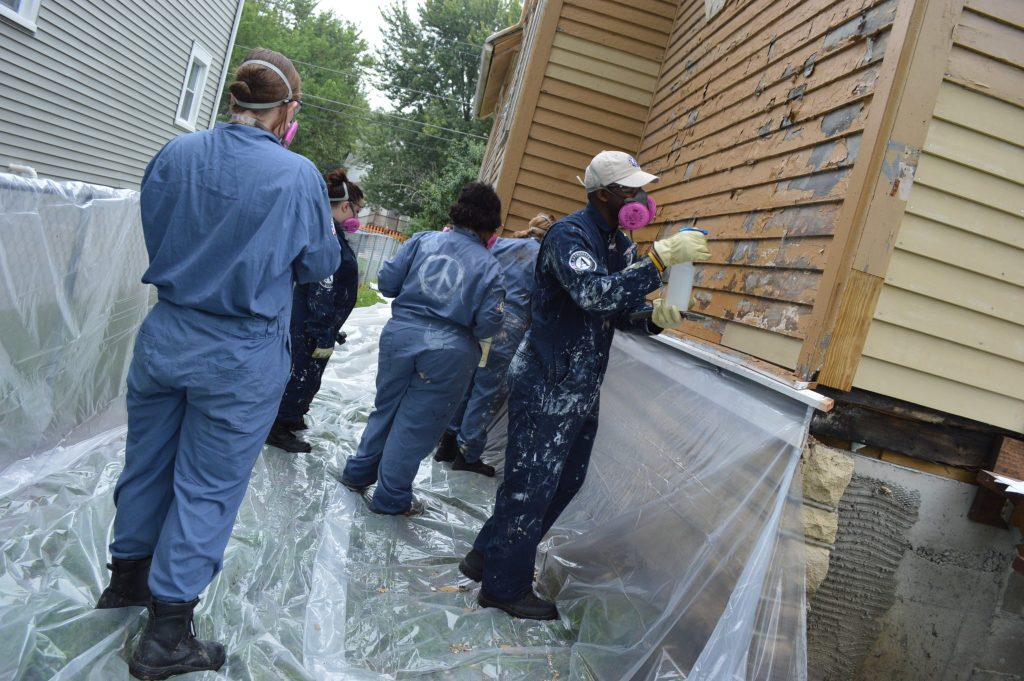 AmeriCorps NCCC members begin work on the Frankie House on Aug. 12, 2016. The house was moved to its current site in Cedar Rapids in September 2015. (photo/Cindy Hadish)