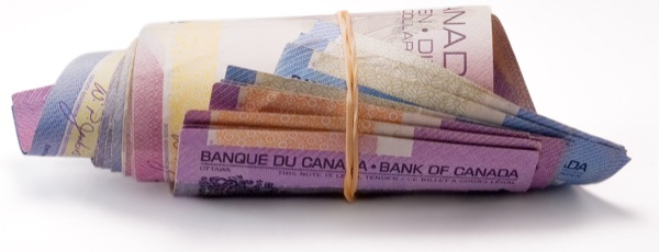 stock-photo-money-cash-bills-rolled-canada