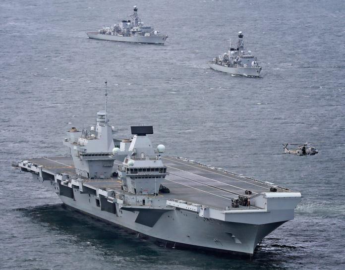 https://i1.wp.com/www.savetheroyalnavy.org/wp-content/uploads/2017/07/HMS-Queen_Elizabeth-Escort-Fleet.jpg?resize=696%2C545&ssl=1